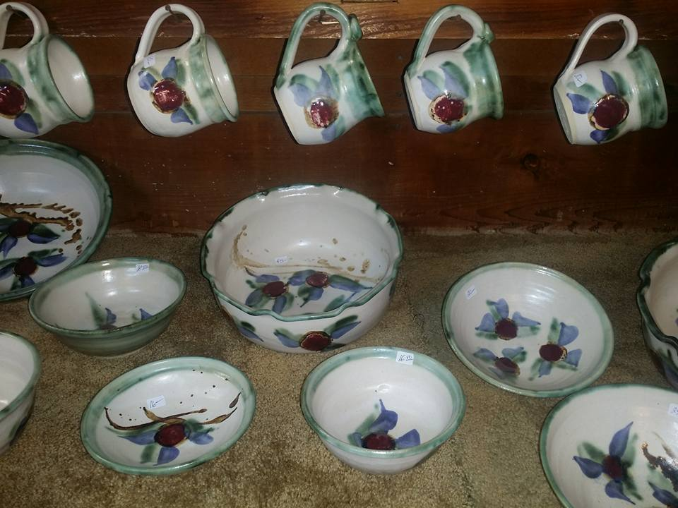 white-and-blue-pottery-with-cups